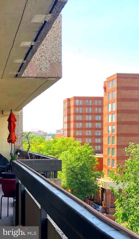 The balcony runs the full length of the condo. - 400 MADISON ST #607, ALEXANDRIA