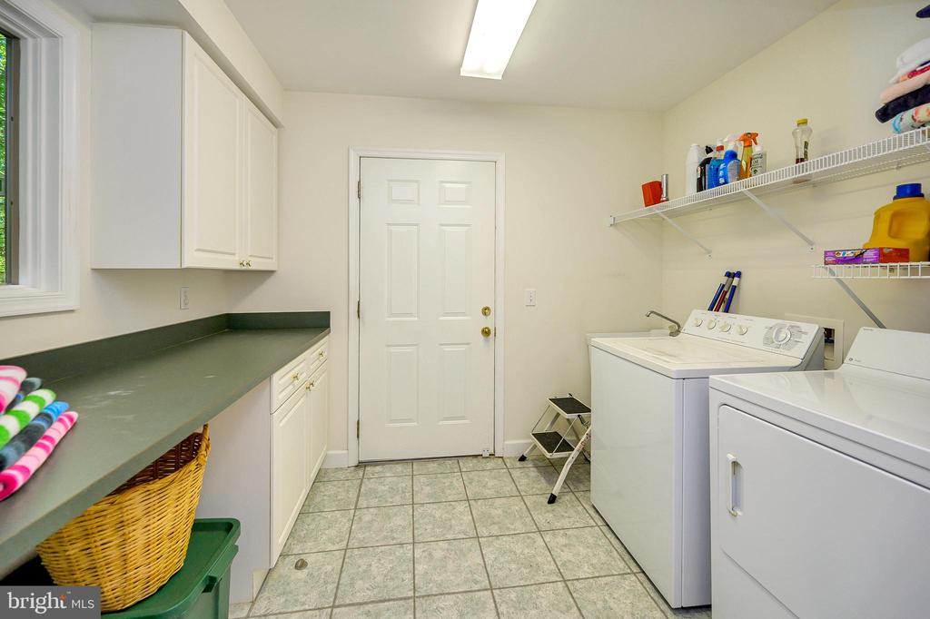 Laundry Room with folding Counter - 124 BIRCHSIDE CIR, LOCUST GROVE