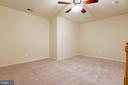 Basement Recreation Room with Ceiling Fan - 1216 GAITHER RD, ROCKVILLE