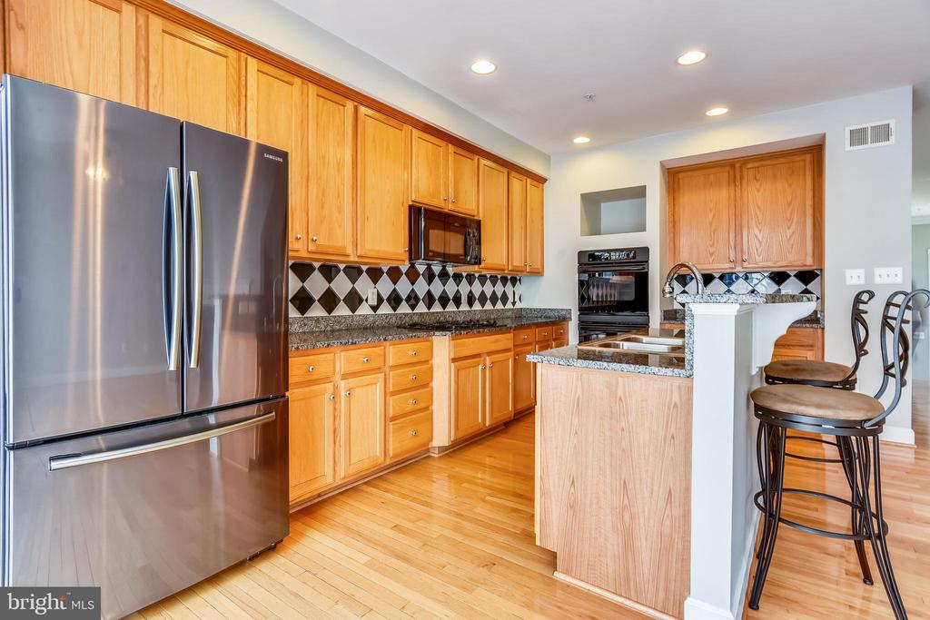 Gourmet Kitchen with HDWDs and Island - 1216 GAITHER RD, ROCKVILLE