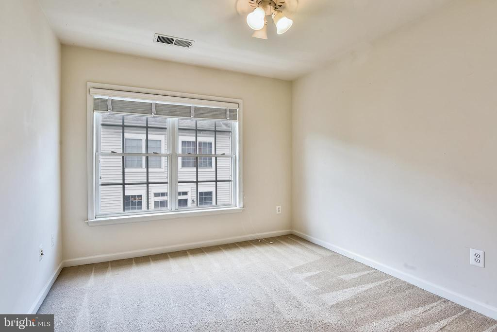 Second Bedroom with Large Windows - 1216 GAITHER RD, ROCKVILLE