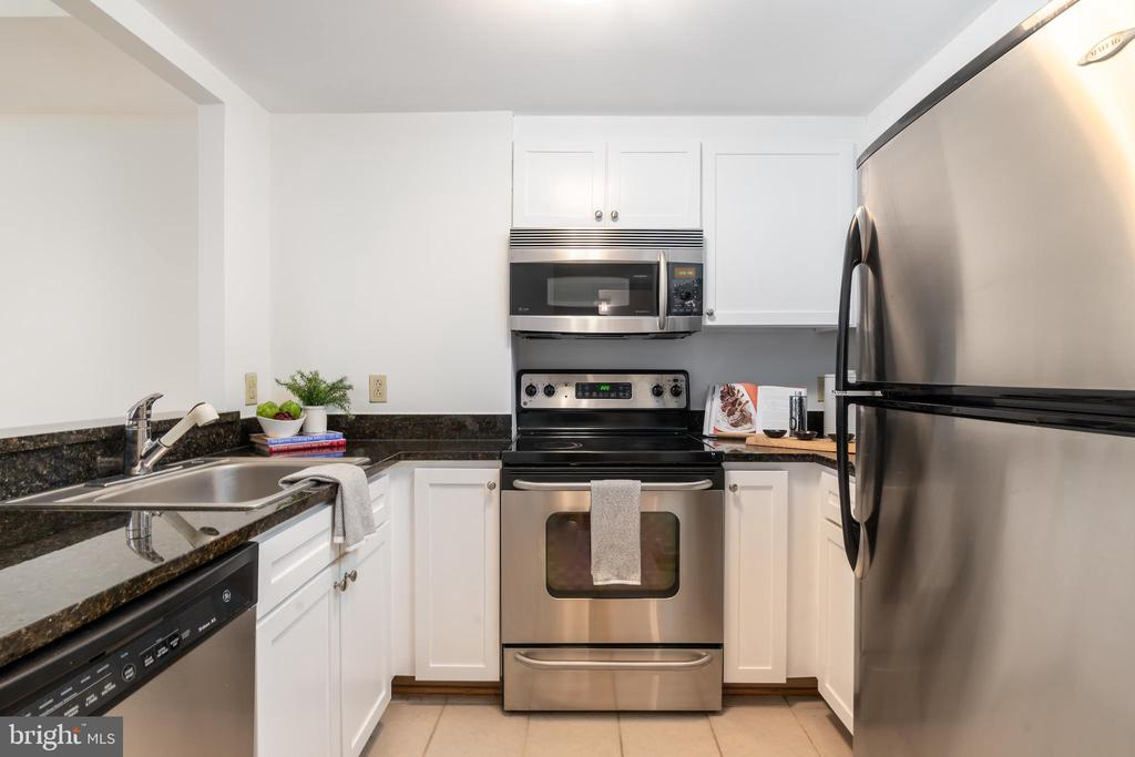 Kitchen with stainless steel appliances - 1150 K ST NW #411, WASHINGTON