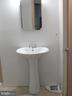 Pedestal sink in basement - 5825 BROOKVIEW DR, ALEXANDRIA
