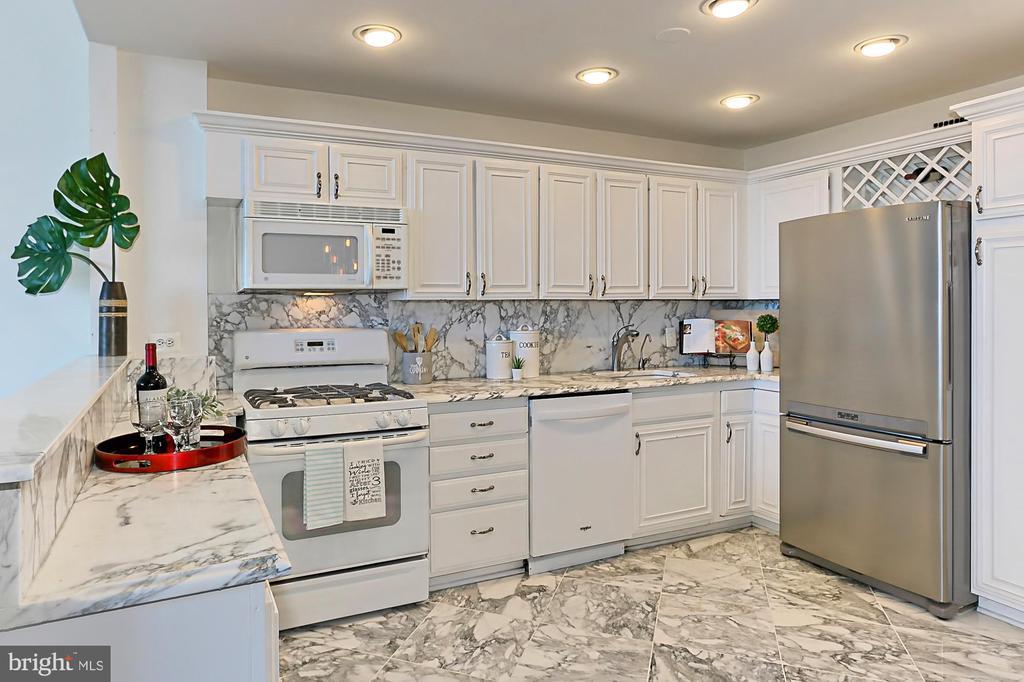 Kitchen - Marble, Recessed Lighting + Storage - 1200 N NASH ST #1148, ARLINGTON