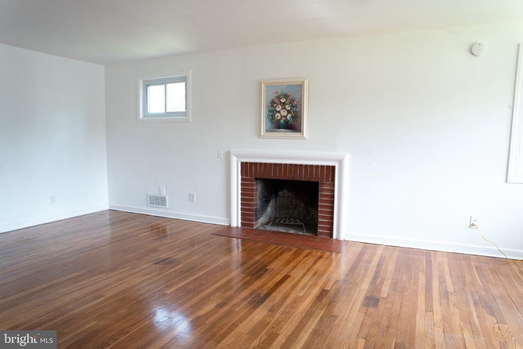 Living room with fireplace - 12501 CONNECTICUT AVE, SILVER SPRING