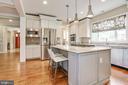 kitchen opens to family room for sociable cook - 3401 N KENSINGTON ST, ARLINGTON