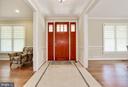 Inviting  foyer highlighted by handsome wood door - 3401 N KENSINGTON ST, ARLINGTON