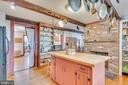 Kitchen, fireplace, hardwood floors - 300 W GERMAN ST, SHEPHERDSTOWN