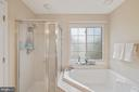 Oversized soaking tub and separate shower - 13011 PARK CRESCENT CIR, HERNDON