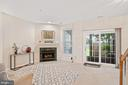 Open lower level family room with gas fireplace - 13011 PARK CRESCENT CIR, HERNDON