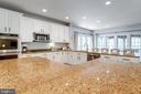 Expansive center island with gorgeous granite top. - 2796 MARSHALL LAKE DR, OAKTON