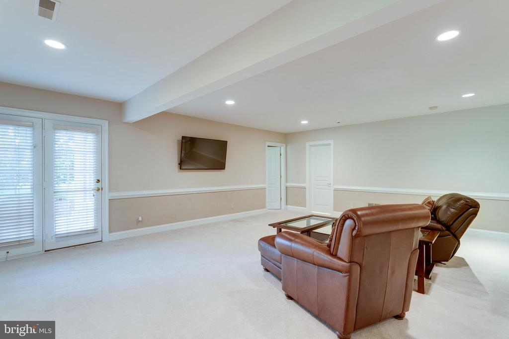 Lower level family room opens to rear patio. - 2796 MARSHALL LAKE DR, OAKTON