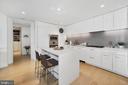 Plentiful cabinets w/ pantry and breakfast island - 1111 24TH ST NW #42, WASHINGTON