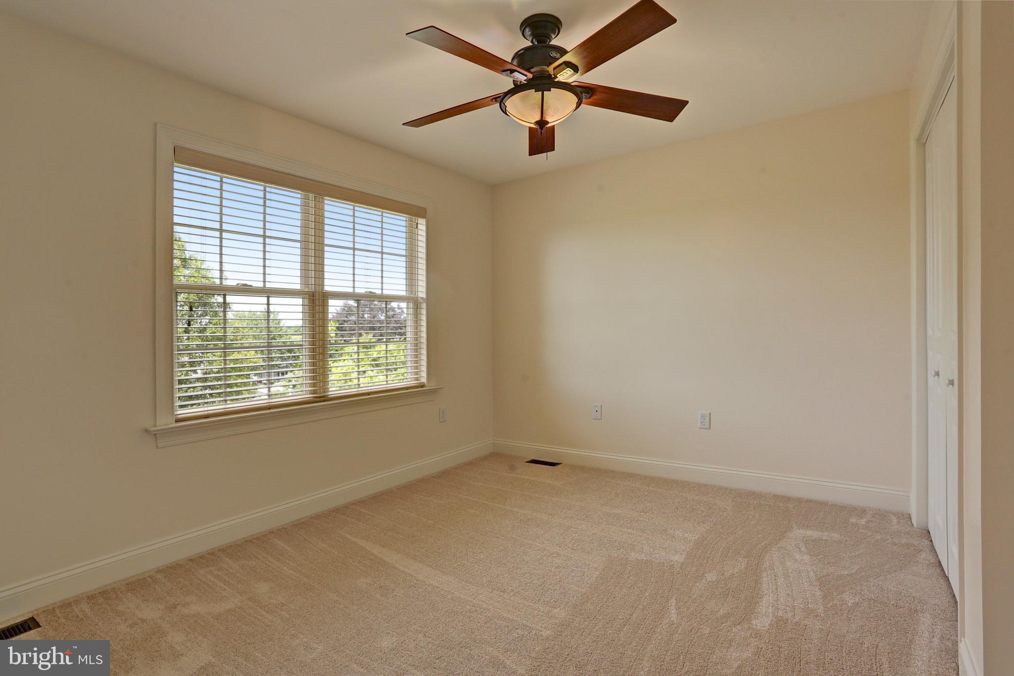 Bedroom 5 with Carpet and a Ceiling Fan