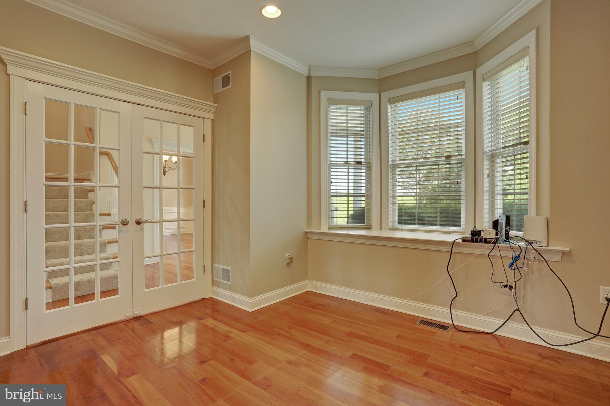 Private Office Room with Cherry Wood Floors