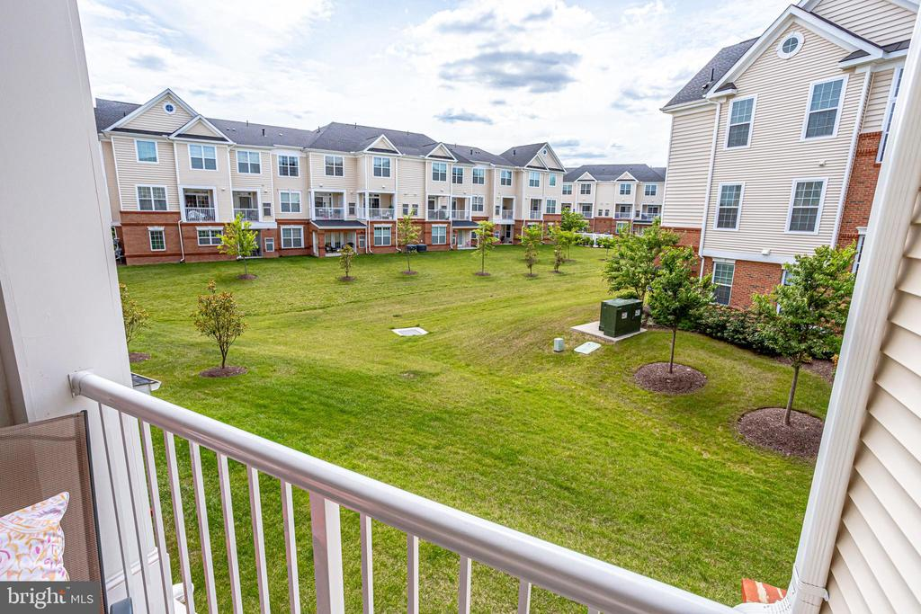 Covered Balcony Overlooking Green Space - 23297 SOUTHDOWN MANOR TER #116, ASHBURN