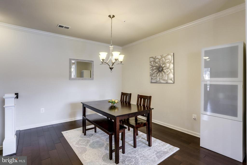 Dining Area with Gleaming Hardwood Floors - 23297 SOUTHDOWN MANOR TER #116, ASHBURN