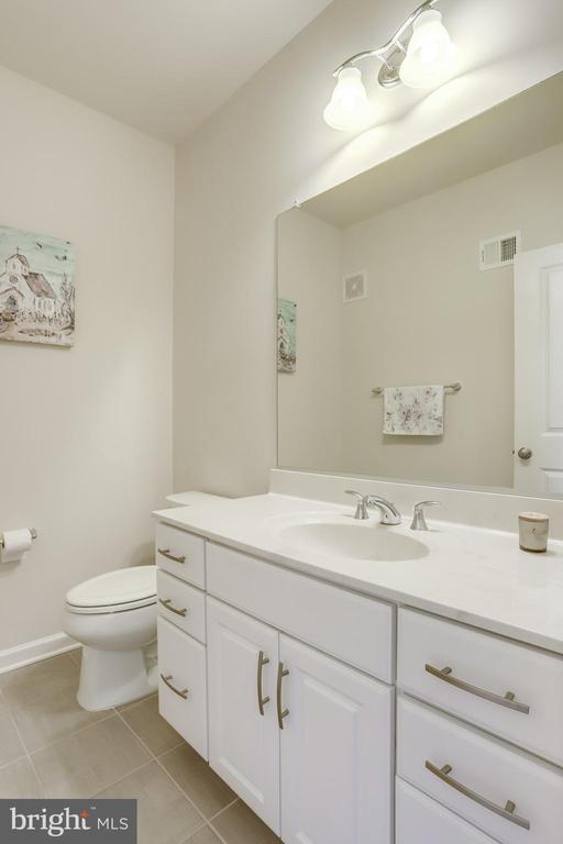 Main Level Powder Room with Tile Flooring - 23297 SOUTHDOWN MANOR TER #116, ASHBURN