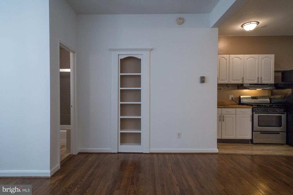 Bookcase is hidden door to walk-in closet - 1300 MASSACHUSETTS AVE NW #205, WASHINGTON