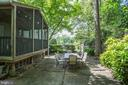 patio surrounded by greenery - 3831 N ABINGDON ST, ARLINGTON