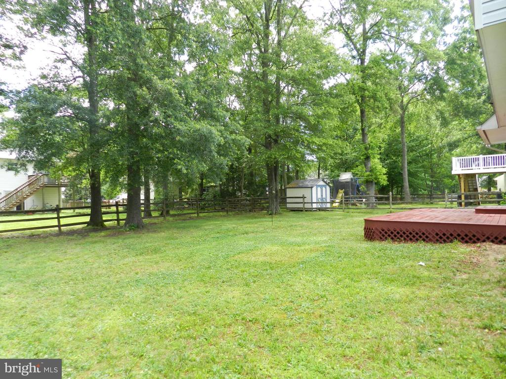 Mature trees and freshly stained deck. - 10118 S FULTON DR, FREDERICKSBURG