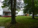 View from back corner, mature shade trees. - 10118 S FULTON DR, FREDERICKSBURG