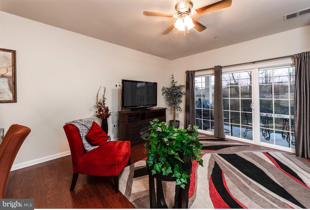 Family room with hardwood - 160 BURLEY ST #101, STAFFORD