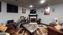 Lower level family room has cozy gas fireplace - 302 HEDGESTONE TER NE, LEESBURG