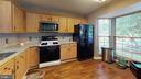 Updated kitchen boasts granite, newer appliances - 302 HEDGESTONE TER NE, LEESBURG