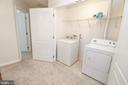 Upper level laundry closet - 25236 WHIPPOORWILL TER, CHANTILLY