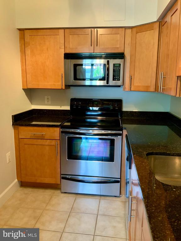 Galley Kitchen with Stainless Steel Appliances - 3802 PORTER ST NW #302, WASHINGTON