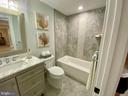 Lower level full bath. Herringbone tile accent. - 705 N BARTON ST, ARLINGTON