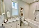 Main level full bath. Beautiful tile detail. - 705 N BARTON ST, ARLINGTON
