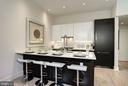 Open kitchen, high ceilings, south facing. - 1745 N ST NW #211, WASHINGTON