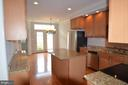 Open kitchen with center island to breakfast area - 506 LAWSON WAY, ROCKVILLE