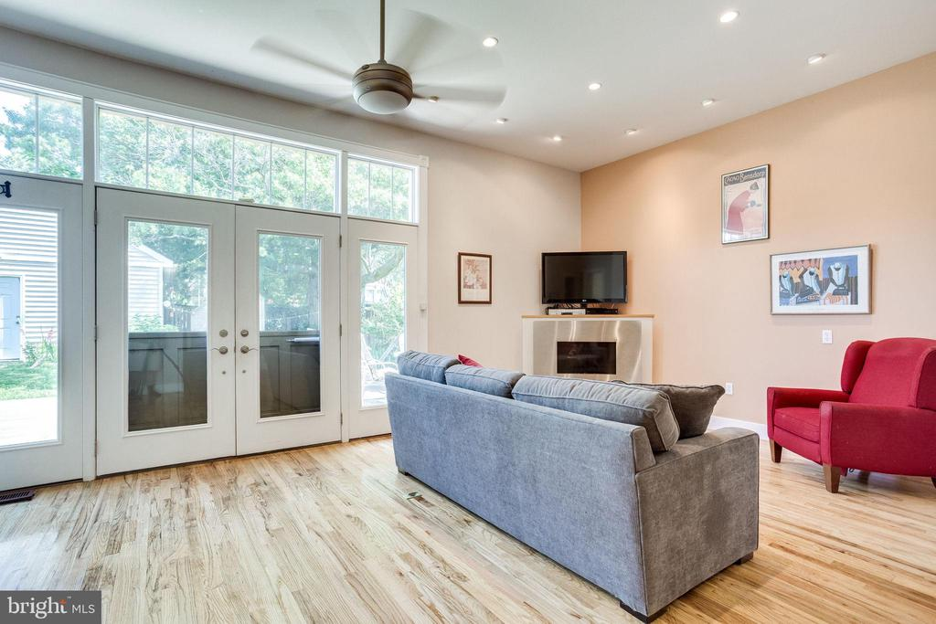 Family room w/ fireplace and tons of natural light - 1504 IRVING ST NE, WASHINGTON
