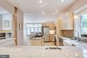Open kitchen w/ granite and stainless appliances - 1504 IRVING ST NE, WASHINGTON