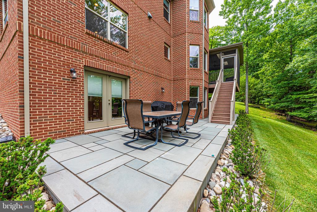 Outside patio, just off covered deck or basement - 6799 ACCIPITER DR, NEW MARKET