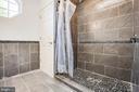 Primary Bathroom Updated Stone Tile Shower - 1847 CEDAR COVE WAY #201, WOODBRIDGE