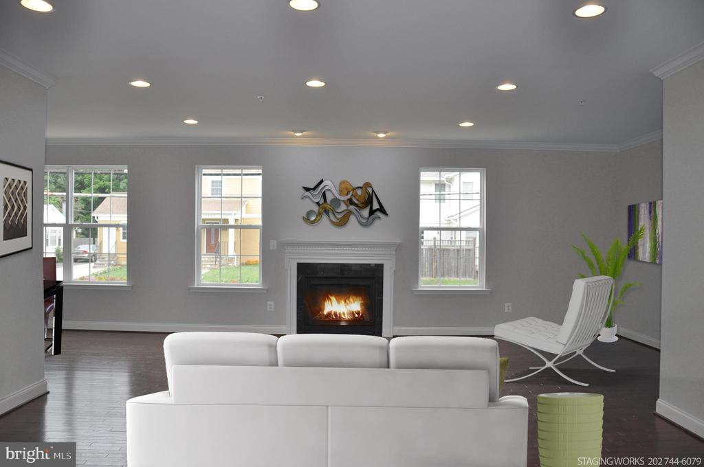 LIVING ROOM WITH GAS FIRPLACE & MANTEL - 10307 DETRICK AVE, KENSINGTON