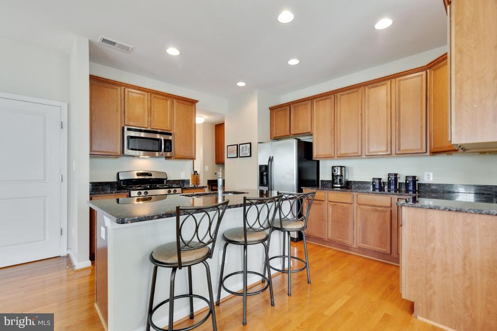 Open Kitchen  with Breakfast Bar - 23402 HIGBEE LN, BRAMBLETON
