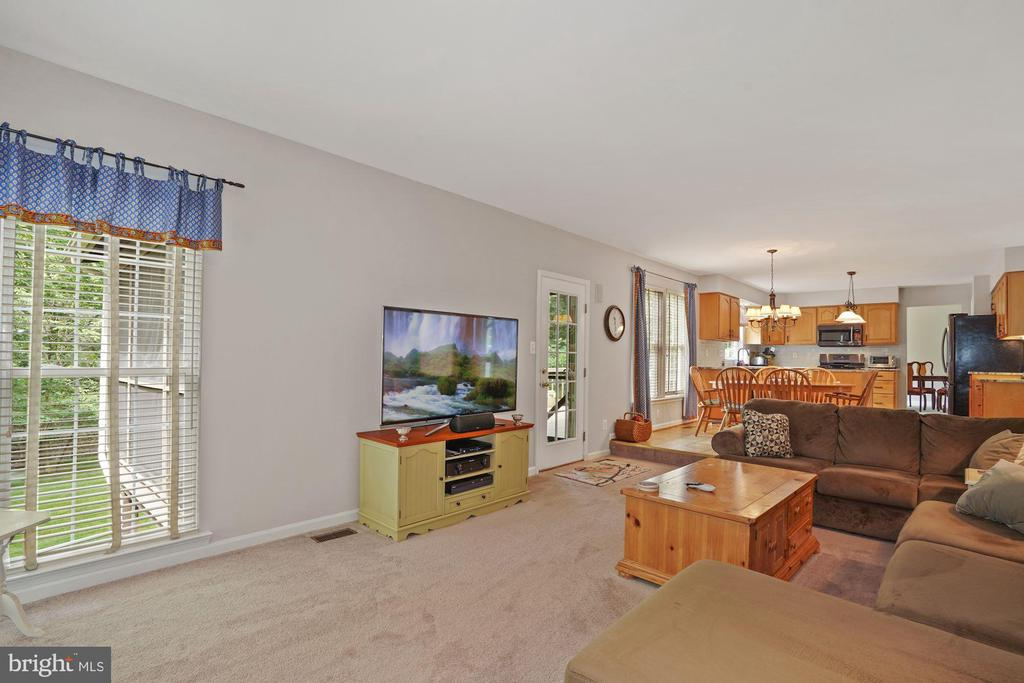 The family room opens to the screened porch - 20311 BROAD RUN DR, STERLING