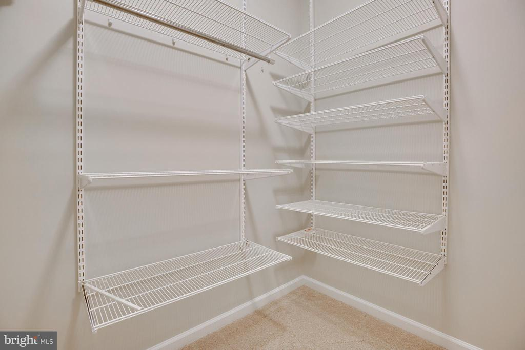 Owners' Walk-In Closet with Adjustable Shelving - 22755 SETTLERS TRAIL TER, BRAMBLETON