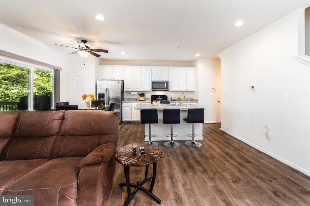 Main Level Family Room/Kitchen With LTV Flooring - 4 WELLSPRING DR, FREDERICKSBURG