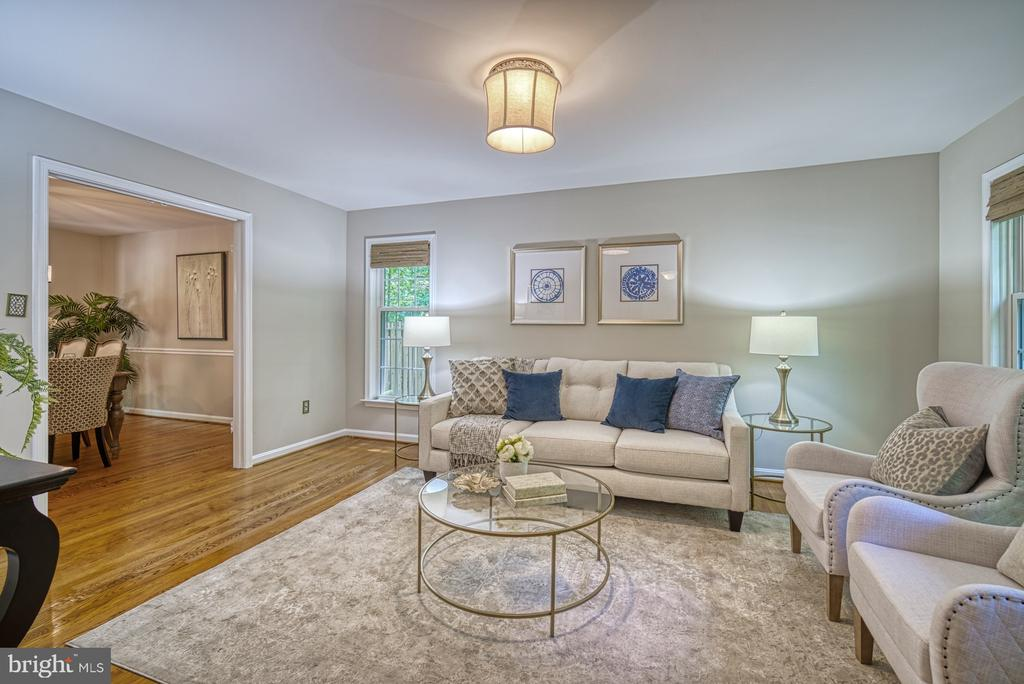 Gorgeous hardwood floors in the formal living room - 12302 CANNONBALL RD, FAIRFAX
