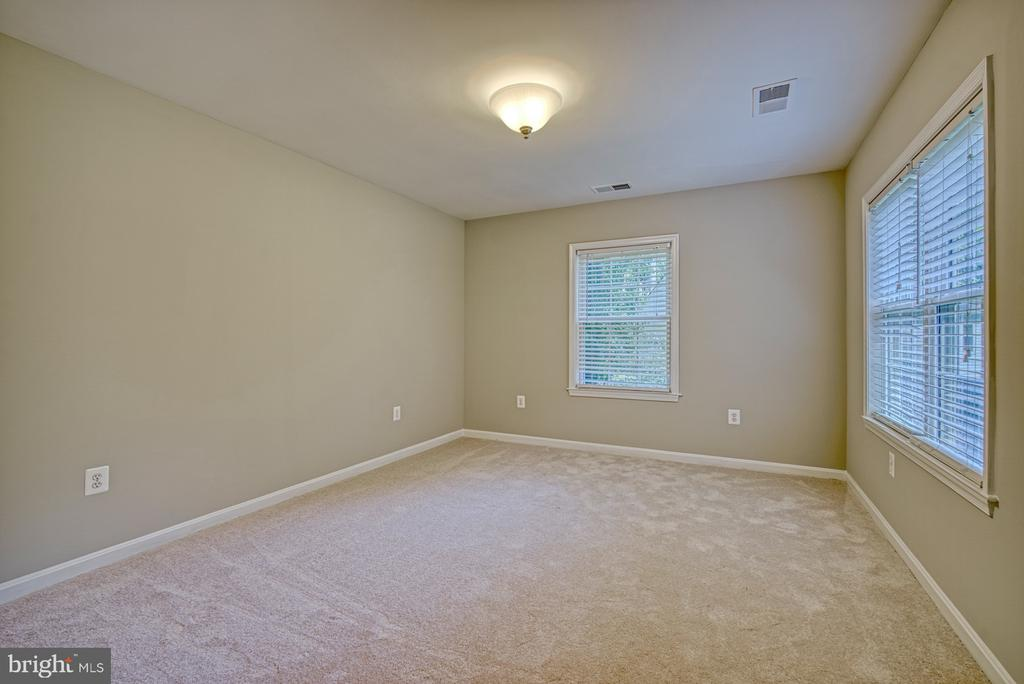 Bedroom 4 with views of the rear yard - 12302 CANNONBALL RD, FAIRFAX