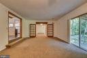Family room with sliding door to private setting - 6407 DEERSKIN DR, FREDERICKSBURG