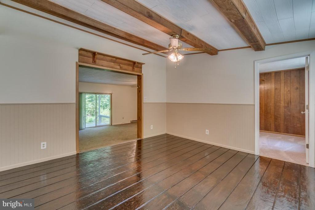 Living/Dining room with view to family room - 6407 DEERSKIN DR, FREDERICKSBURG