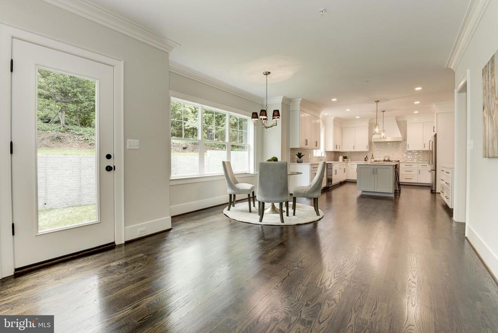 From family room into kitchen - 8609 SEVEN LOCKS RD, BETHESDA