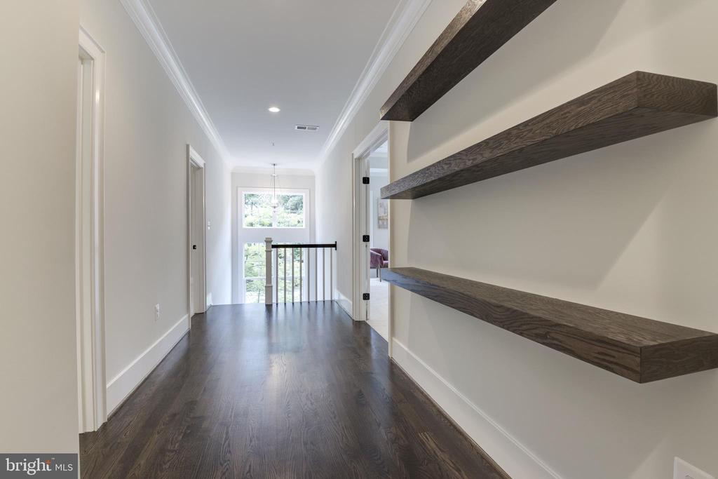 Upper level hallway with floating shelves - 8609 SEVEN LOCKS RD, BETHESDA